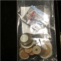 (35) Various Foreign Coins including at least one Silver. Never catalogued.
