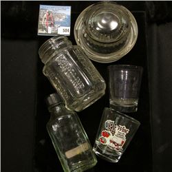 "(2) Different Shot glasses from the Amana Colonies; ""Moroline"" Bottle; Glass lid for a compote; and"
