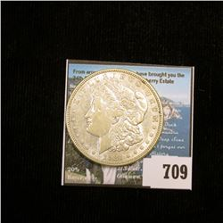 1921 D U.S. Morgan Silver Dollar in a Special Holder, Choice AU  with American Historic Society pape