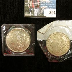 Pair of 1921 P U.S. Morgan Silver Dollar, EF-AU, one in original Littleton Coin Co. cellophane.