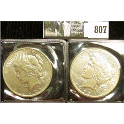 1922 P & S U.S. Peace Silver Dollars, EF-AU, both with C.O.A.s from the American Historical Society.