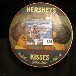 Hershey's Milk Chocolate Kisses Tin container with approximately 150 various foreign coins and token