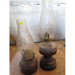 2 clear glass oil lamps (oil in them)