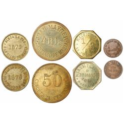 Lot of four El Salvador tokens in brass or bronze, late 1800s to early 1900s.