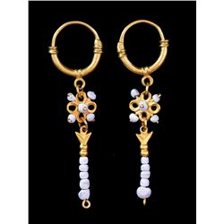 Matched pair of gold-and-pearl earrings from the 1715 Fleet.