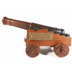 Miniature handmade wood cannon and carriage with wood from the USS Constitution.