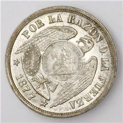 """Guatemala, 1 peso, """"1/2 real"""" counterstamp of 1894 on a Santiago, Chile, 1 peso, 1877."""