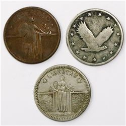 Lot of three silver and copper US slot machine tokens, ca. 1920s, LIBERTAD, Standing Liberty quarter