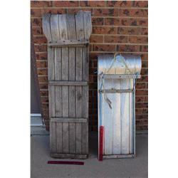 Two Tobogganing Sleds (One Wooden, One Metal)