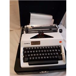 Olympia Portable Typewriter With Case