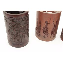 Lot of four 19th century Japanese brush  holders crafted from carved bamboo.  The lot  includes four