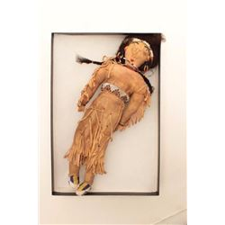 "Beaded on buckskin doll in display; Indian  style, 13"" -14"".       Est.:  $75-$150"
