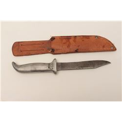 In-theater made WW II era fighting knife;  aluminum grip; leather scabbard.        Est.:   $100-$200