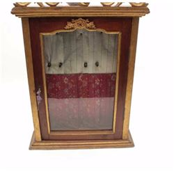 Antique wood and glass showcase for wall to  possibly display Japanese tanto's showing a  red floral