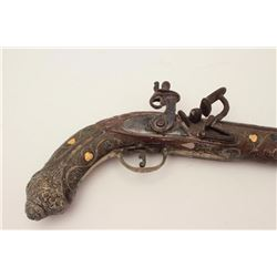 20th century manufactured North African  flintlock pistol, approximately .65 caliber.   The pistol i