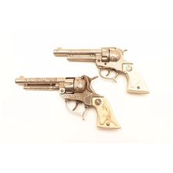 Texan and Texan Jr. vintage cap guns; Texan  shows Colt logo and heavy construction.             Est