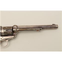 Colt SAA revolver, modified to .22 caliber  (different barrel and cylinder) with top  strap of frame