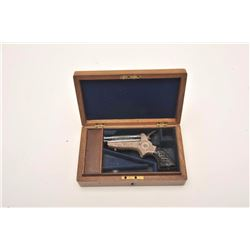Tipping & Lawden Sharps four barrel  derringer, finely and extensively scroll  engraved, blued finis