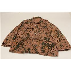 Waffen S.S. tunic from WWII showing 44 dot  pattern. Letter of provenance documenting  bring back an