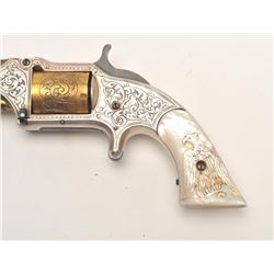 Smith & Wesson Model 1-1/2 tip up spur  trigger revolver, Nimschke engraved, old  re-finish of silve
