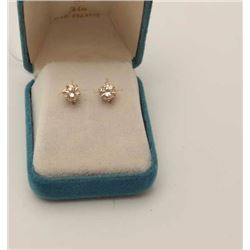 One pair of diamond stud in 14k yellow gold,  diamonds weighing approx 1.5ct total wt.  Champagne co