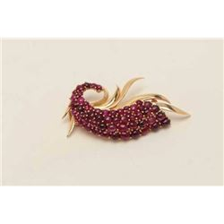 One antique peacock tail brooch in 14k yellow  gold set with approx 5ct of cabochon  rubies(17gms).
