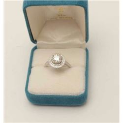 One 14k white gold halo style  ring set with  a  diamond approx. 1.25ct color 1 VS2 and  0.30ct on s