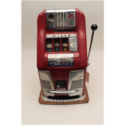 Mills hi-top .25 cent slot machine. Working  with cash box. No key. Est.: $900-$1800