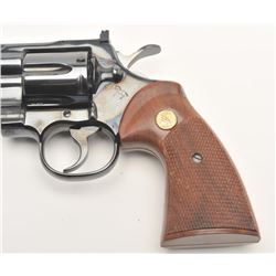 "Colt Python DA revolver, .357 Magnum caliber,  4"" ventilated rib barrel, blued finish,  checkered wo"