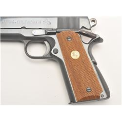 "Colt Combat Commander semi-automatic pistol,  .45 caliber, 4.25"" barrel, blued finish,  checkered wo"