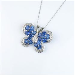 Exquisite designer Butterfly pin/pendant  featuring eighteen oval Ceylon sapphires  weighing approx.