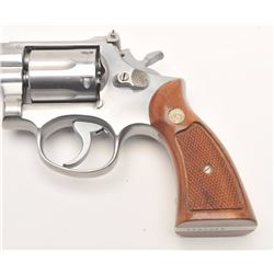 "Smith & Wesson Model 67 DA revolver, .38 S&W  Special caliber, 4"" barrel, stainless,  checkered wood"