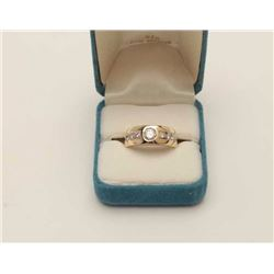 One 14 yellow gold mans ring set with center  diamond approx 0.50ct and 6side diamonds  weighing 0.2