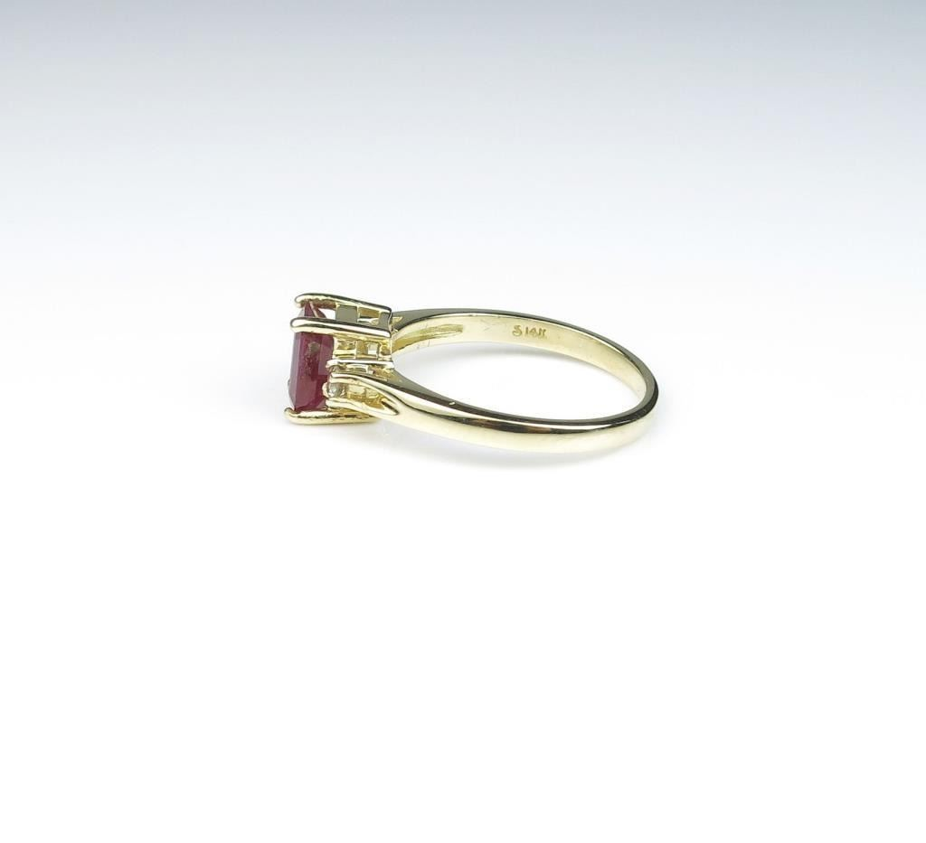Very nice ring featuring a red Emerald cut Ruby weighing over 1.00 ...