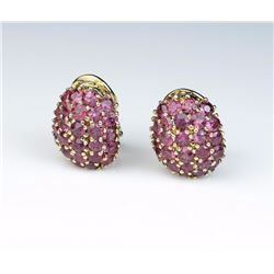 Gorgeous ladies earrings set with 56 round  pink Tourmalines weighing approx. 4.00 carats  in a 14 k