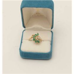 One fine marquee emerald and diamond ring set  in 14k yellow gold Est.$500-600