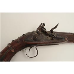 "Mid-Eastern flintlock trade pistol, .70  caliber, 14"" barrel, wood stock, brass tacked  and decorate"