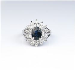Dazzling ring featuring a blue Sapphire  weighing approx. 1.50 carats and surrounded  by 28 full cut