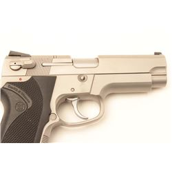 "Smith & Wesson Model 4006 DA semi-automatic  pistol, .40 S&W caliber, 4"" barrel,  stainless, checker"
