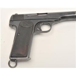 "FN semi-automatic pistol, 9mm caliber, 4.5""  barrel, blued finish, checkered hard rubber  grips, S/N"