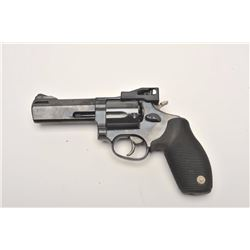 "Taurus Tracker Model DA revolver, .44 Magnum  caliber, 4"" ported barrel, blued finish, hard  rubber"