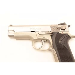 "Smith & Wesson Model 4003 semi-automatic  pistol, .40 S&W caliber, 4"" barrel,  stainless, checkered"