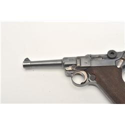 "Luger semi-automatic pistol by DWM, 9mm  caliber, 4"" barrel, blued finish, checkered  wood grips, S/"