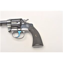 "Colt Police Positive DA revolver, .38  caliber, 4"" barrel, blued finish, checkered  hard rubber grip"