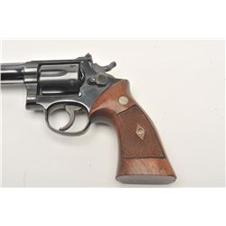"Smith & Wesson DA revolver, 5-screw frame,  .22LR caliber, 6"" barrel, blued finish,  checkered wood"