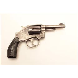 "Smith & Wesson DA hand ejector revolver, .32  Winchester caliber, 4"" barrel, blued finish,  checkere"