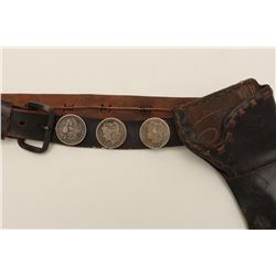 Classic old double loop leather holster for  what may be a Colt Lightning revolver, with  leather be