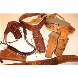 Two leather flap holsters for Luger  semi-automatic pistols, one black, one brown.        Est.:  $20
