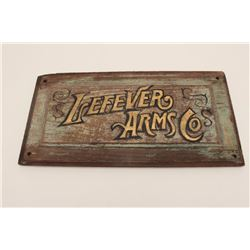 """Old looking wood sign with flaking paint  marked """"Lefever Arms Co"""", approximately 11"""" x  21""""; unknow"""