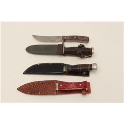 Lot of knives including 1. Military ground  and sharpened blade; black scabbard; WW II  era; 2. Schr